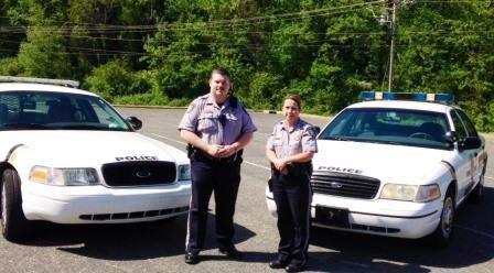 School Resource Officers Posing with their Vehicles